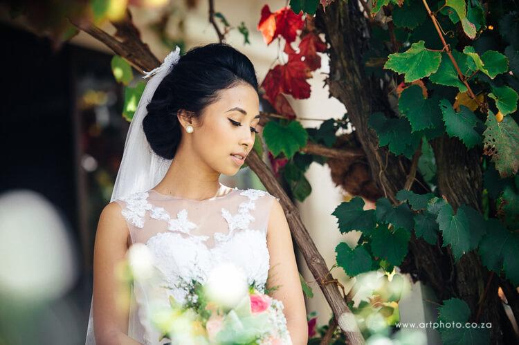 Bride looking at Flowers