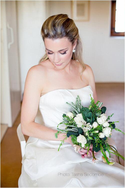 Bride looking down natural makeup